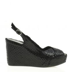 Fancy wedge in woven black leather