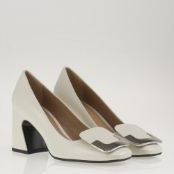 White patent leather brooch pump